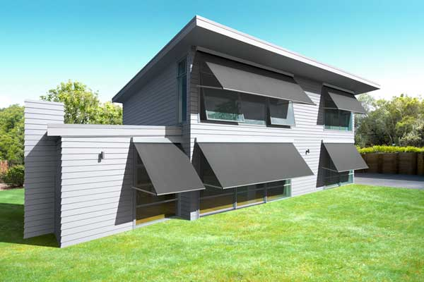 Dark grey awnings complement light grey home