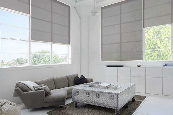 Grey roller blinds with mid level opacity for large windows