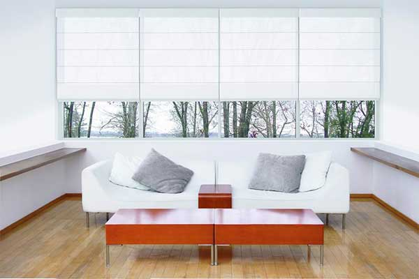 White set of 4 roman blinds for consecutive windows with partial opacity