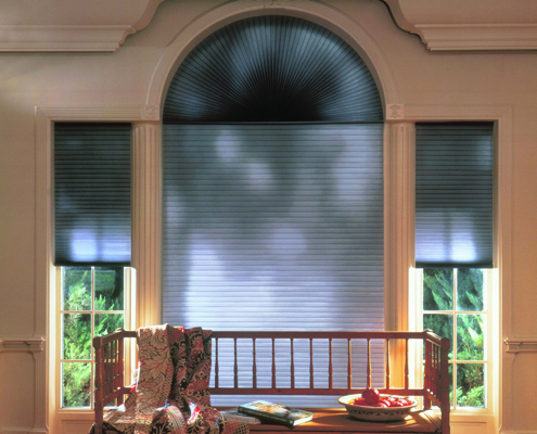 Arched windows with cellular blinds honeycomb pockets
