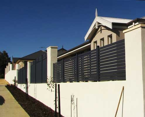 Screenloc slatted fencing in dark powder coated finish