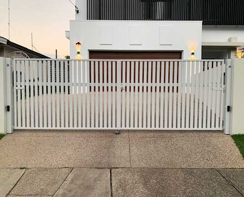 Vertical slatted white fence providing privacy and security from Hometec Screenloc