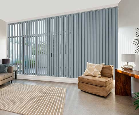 Grey Vertical blinds for use on expansive glass windows.