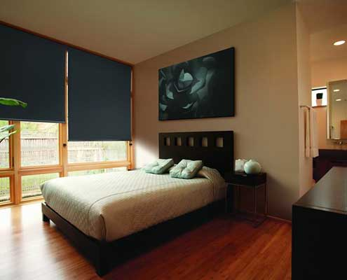 Dark bottle green roller blinds with blockout fabric for a good night sleep