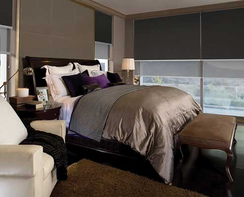 Bedroom setting using dual roller blind system for block out fabrics for a good night sleep or light fabric for daytime privacy
