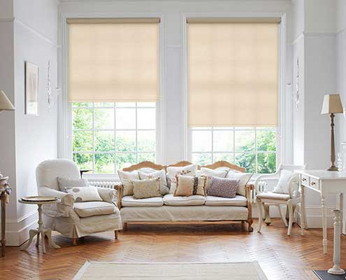 Peach Roller blinds on tall windows for easy operation
