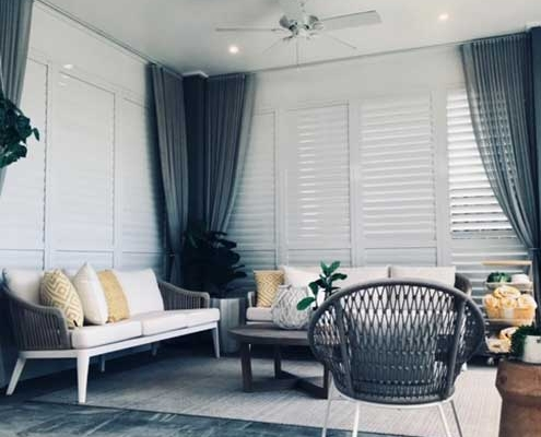 Shutters with sheer curtains give added privacy
