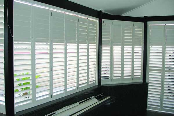 White Shutters in Black fram