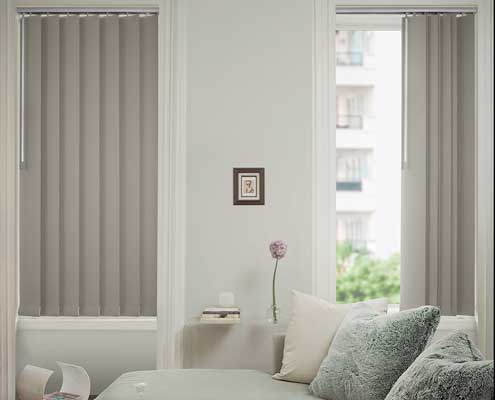 Vertical blinds on two windows in the lounge room - one option is to open along tracking system