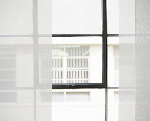 White opaque panels allow views to the outside even with the panel vane blinds are closed.