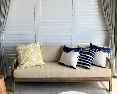 Shutters with sheer curtains for added privacy