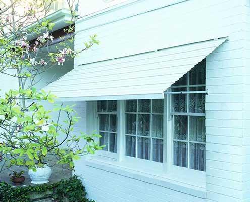 White slanted fixed aluminum awning