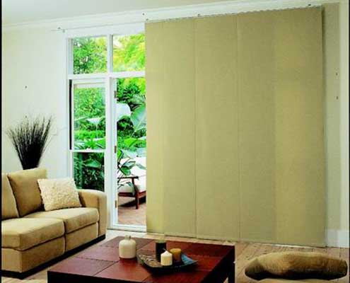 dark cream panel blinds on tracking system
