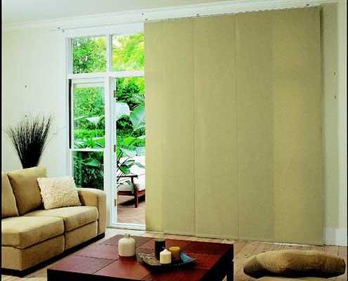 dark cream panel blinds on tracking system