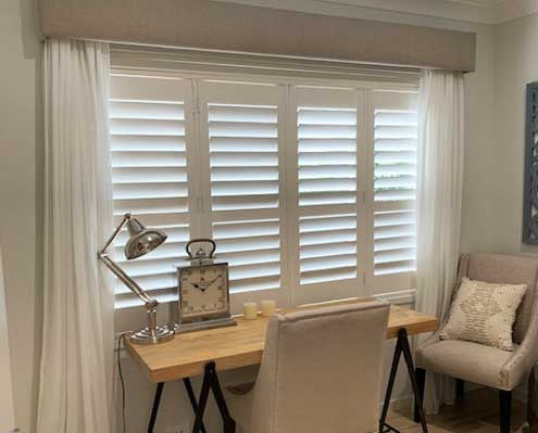 Sheers with shutters give added privacy and convenience