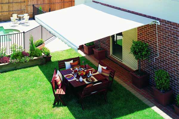 Expansive coverage and shade of a folding arm awning outdoor settings for alfresco dining