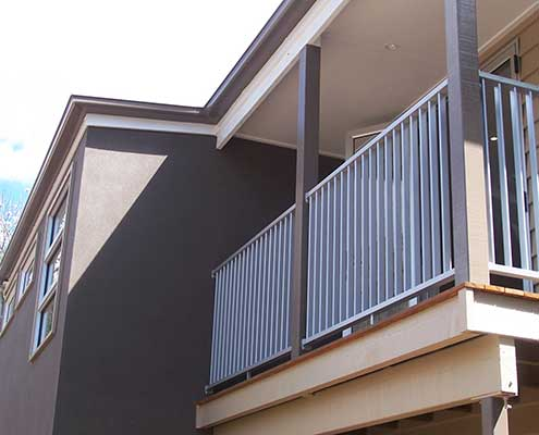 Slatted fencing and balustrading in a blue finsih for yoru balcony