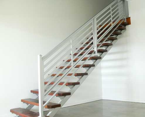 White aluminium blaustrading for an indoor stair case