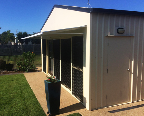 Outside shed with fixed metal awning