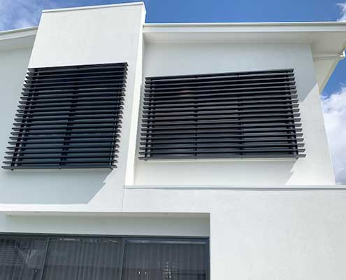 Slatted privacy screens from Hometec Screenloc provide architectural features to your home