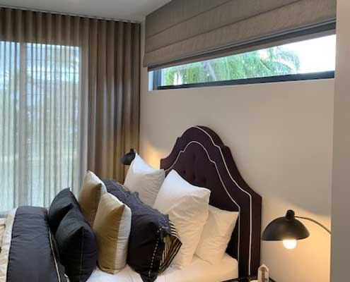 Combination of sheer curtains and roman blinds