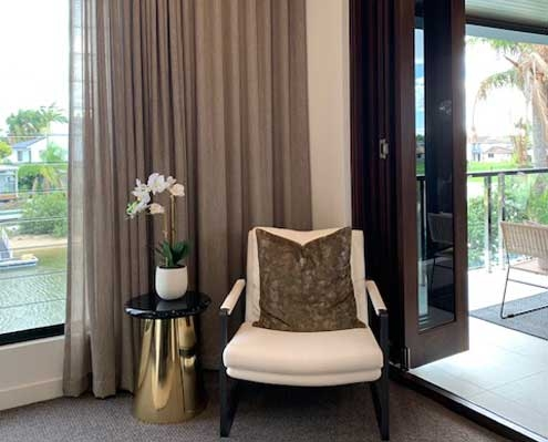 Application of complementary colour sheer curtains in the lounge room