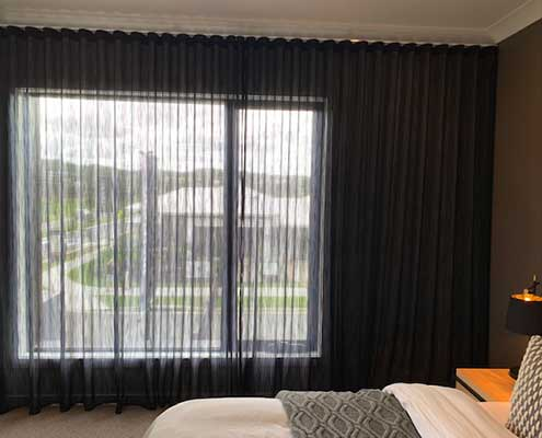 dark sheer curtains with fabric from Maurice Kain