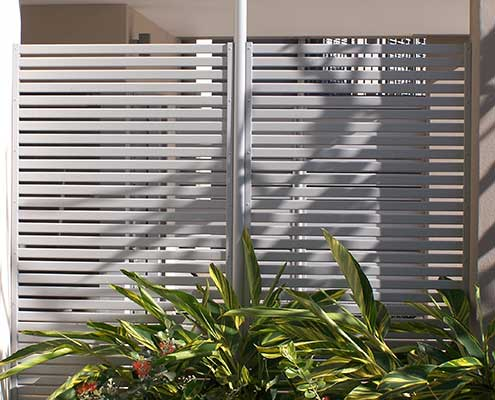 Hometec slatted privacy fence in wallaby powdercoat finish